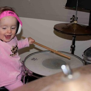 ems-4-bubs-baby-earmuffs-lucy-playing-drums
